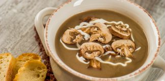 A bowl of Wild Mushroom Soup with a side of toasted crostinis.