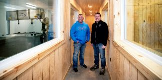 Brothers Todd, left, and Jason Frye stand in between rooms where they will make cheese at left, and teach about cheese at right.