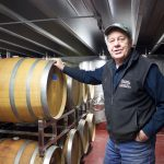 Tony Debevc, owner of Debonné Vineyards, in Madison, Ohio, stands in front of barrels of wine in the basement of the winery, Jan. 22.