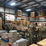 national guard members packing food