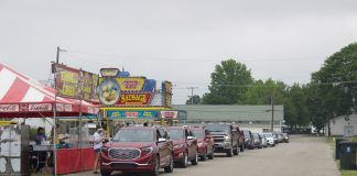 Cars line up next to concessionaires' stands at the Canfield Fairgrounds.