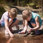 children playing in a stream