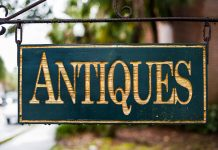 "A sign reading ""antiques."""