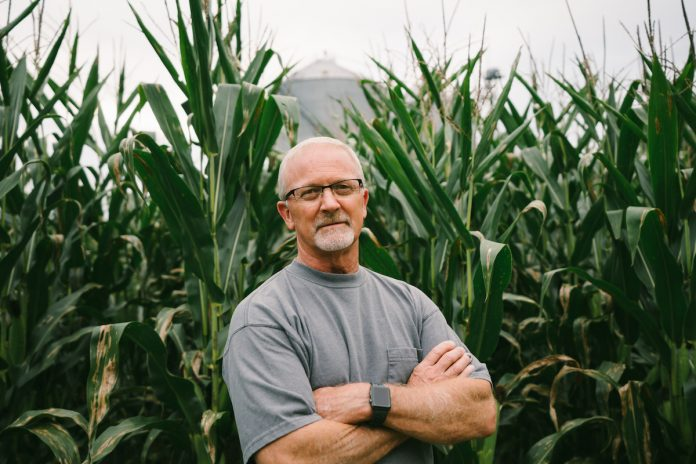 john linder stands in corn field