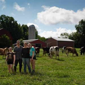 family standing in pasture