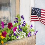 american flag in a flower box