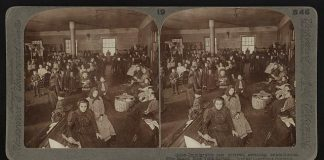 immigrants waiting in Ellis Island for examination