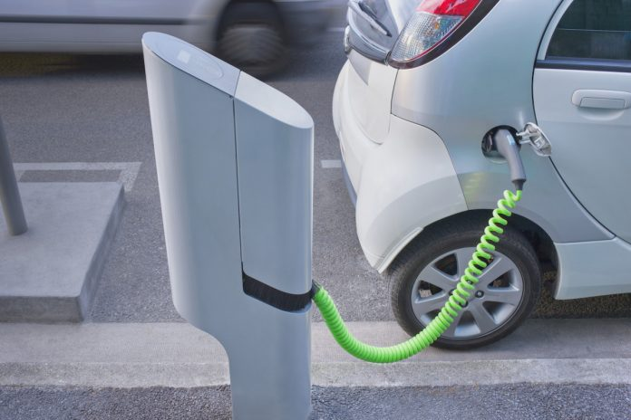electric car plugged into a charger