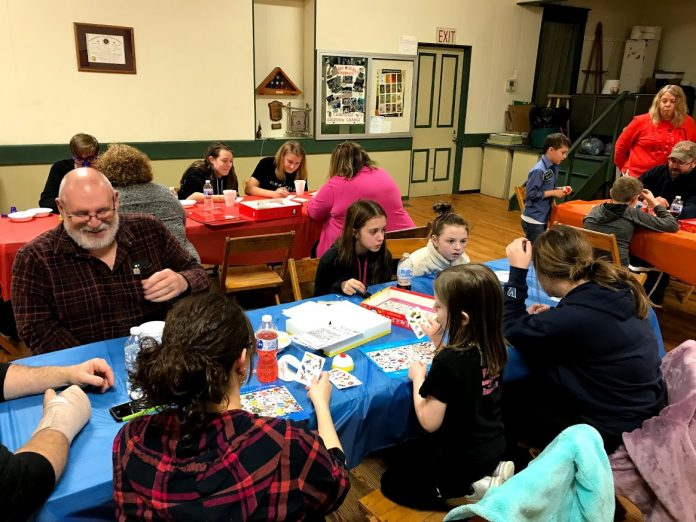 people play board games together
