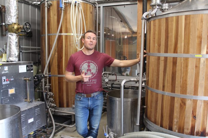 guy standing in brewery
