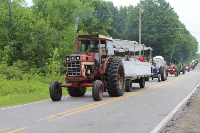 tractors cruising down the road