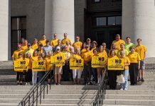 group of anti-wind folks on steps in Ohio